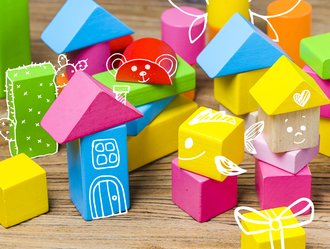 Image of colorful building blocks with drawings on them.